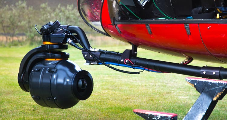 A camera set up below a helicopter.