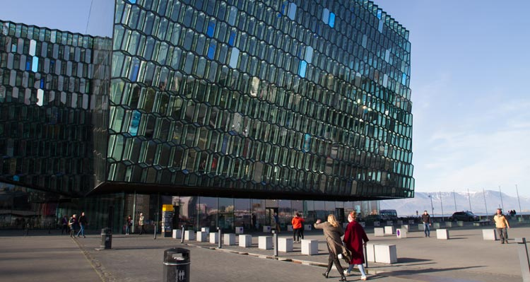 The glass walled Harpa concert Hall on the Reykjavík shore.