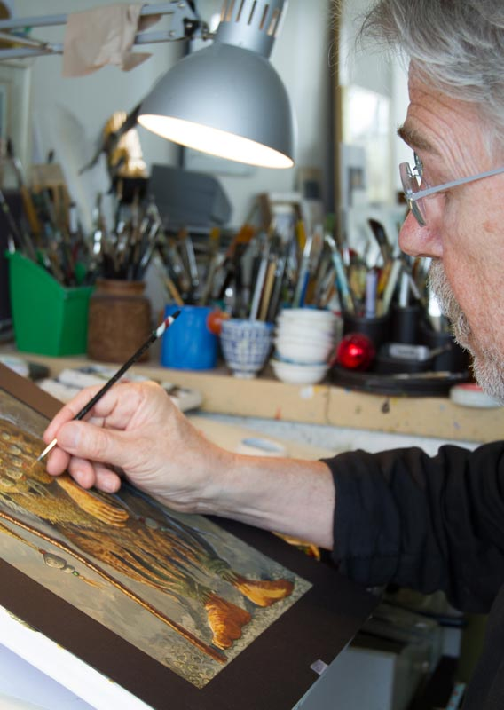 Brian Pilkington works at his illustration studio.