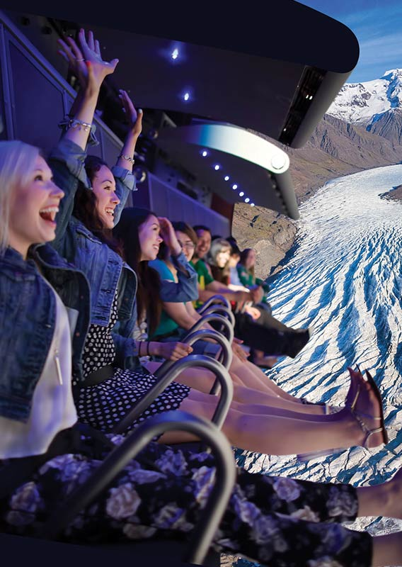 A group of people are excited to be on the FlyOver Iceland flight ride